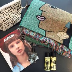Travel essentials with our Mudcloth Wasbag, @moon_magazine holiday reading, @ortigiasicilia travel perfume and products in Fico D'India scent, and @bfgf parallel movements blanket featuring shell earrings 🐚🌙🌴 #anewtribe #anewtribetravels #chatsworthroad #bfgfblanket #moonmagazine #mudcloth #travelessentials #whatsinmybag #shellearrings