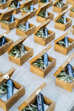 Instead of traditional escort cards, Stefanie Cove and Company had wooden boxes made in a nearby town, then filled them with fresh herbs and a jewel-toned stone adorned with guests' names calligraphed by Julie Song Ink.