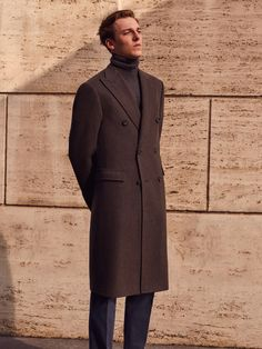 Maxi #coat, double-breasted 6 buttons, in pure mélange cashmere, marron glacé colour, with peak lapels, half-belt, set-in sleeves and flap pockets.  #Jumper with polo-neck collar in pure cashmere, gauge 12, beaver mélange colour. #Trousers in emerised cotton drill, powder blue colour, no pleats, with waist adjusters, slant pockets, watch pocket, zip pocket and 19 cm base. #FW17 #Corneliani