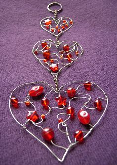 - a beaded heart suncatcher in three parts