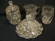 "EAPG Richards and Hartley Glass Co's ""Question Mark"" 4 Pc. Table Set, circa 1885.  Butter  5.25""H x 6.75""D,  Spooner 4.75""H x 3.25""D,  Creamer 4.75""H x 3.25""D,  Sugar 7""H x 3 .75""D"