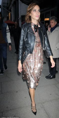 Alexa Chung rocking the dressed up biker look with black leather biker jacket and sequin dress