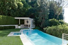Decorator Waldo Fernandez replaced the old pool at his Los Angeles home with a limestone version of his own design and built a poolhouse.