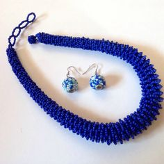 Tribal jewelry set in vibrant cobalt blue. The round beaded earrings are white, light and cobalt blue.