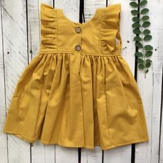 Joy Marie Mustard Dress Mustard is the color for fall. This dress is so perfect for a transition piece. Can be a big sister match for the bubble. Frocks For Girls, Kids Frocks, Little Girl Dresses, Kid Dresses, Baby Dress Design, Baby Girl Dress Patterns, Baby Dress Tutorials, Frock Patterns, Black Kids Fashion