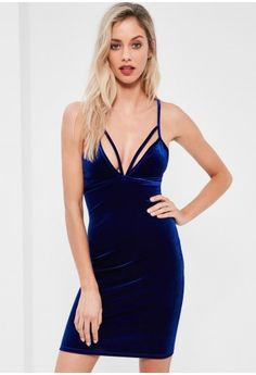 Step up the party season and add some serious texture to raise the game. This dress features a bodycon fit, harness detailing, a dark blue hue and a luxe velvet finish.