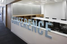 Conference room with glass walls, large signage