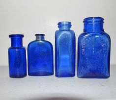 Vintage small cobalt blue medicine and perfume and spice bottles