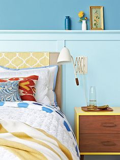 Revive a tired headboard with a length of fabric. Simply cut the fabric to size, hem, and drape over the headboard for an extra pop of pattern and color in your bedroom decor.