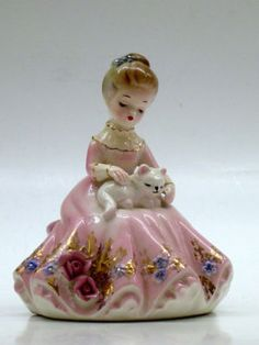 LADY IN PINK DRESS WITH WHITE CAT IN HER LAP.