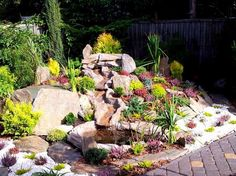 steingarten-anlegen-kleiner-teich-huegel-gesteine
