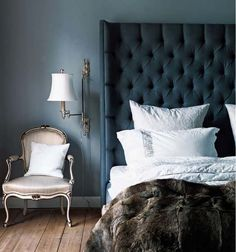 I love the lush headboard, just wish the wallcolor was different so the headboard would pop.