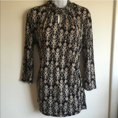 NWOT turtleneck peep hole top. True to size 95% polyester 5% spandex. Firm unless bundled. New York & Company Tops Blouses