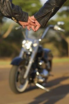 Hand in hand, the two bikers walked to the bike... ride off into the sunset and create an unforgettable memory together...