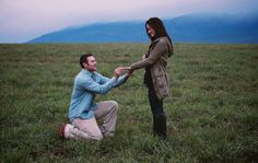 Reenact the proposal! Whitefish, Montana Romantic Engagement Photo in the Field, Big Mountain in the Background.
