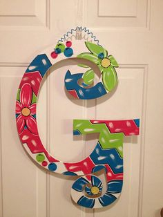 Customized wooden door hangers by PaintingonaPrayer on Etsy