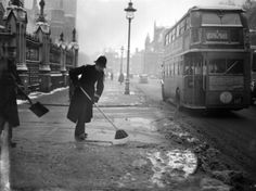 February 7, 1947:  A policeman sweeping snow from outside Westminster. (Photo by Bush/Express/Getty Images)