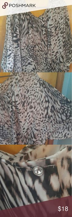 Beautiful animal print blouse Gorgeous animal print blouse. Float material, wide sleeves, with a jewel button on collar. Very pretty top with jeans or dressed up with a skirt or black pants. Jennifer Lopez Tops Blouses