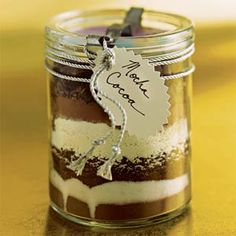 """Mocha Cocoa gift jar -Layer the ingredients for homemade cocoa in a jar, add a ribbon and a tag, and you have a simple but stylish gift. This mix will fill a 1-quart jar (12 servings), but if your containers are different sizes, just keep the ratio of ingredients constant. On the back of the tag, write: """"Mix contents in a large bowl. For each serving, place 1/3 cup cocoa mix in a mug and stir in 1 cup boiling water. Store remaining mix in airtight container."""""""