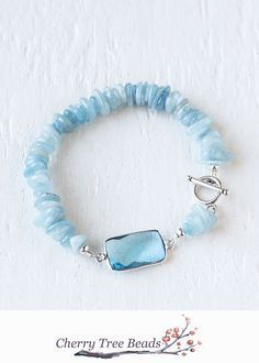 Light blue natural Aquamarine stone beaded bracelet with blue crystal connector. This bracelet is so pretty! I love the glam stone with the natural looking beads.