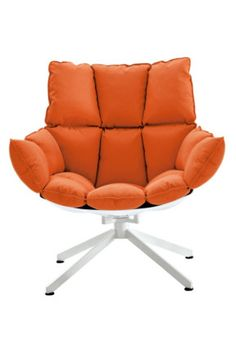 Patricia Urquiola's 'Husk' armchair #orange.  I am loving Orange at the moment, especially with grey & white palettes