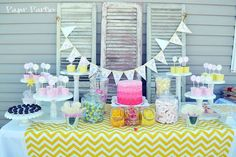 Lemonade Party Table cute tablecloth, pretty colors, and i like the height levels of the food