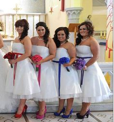 A recent wedding we worked on where all of the bridesmaids wore white dresses but each had a different colour sash with matching shoes and flowers. I love it.