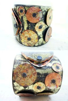 Salvaged tin cuff with riveted African disc beads and alchemy image under resin.