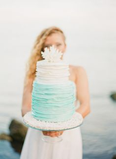 Our Mermaid Inspired shoot Cake by Cloud 9 Bakery Aqua and peach wedding ideas | Real Weddings and Parties | 100 Layer Cake  www.cloud9bakerycafe.com  Seaside ocean wedding aqua seafoam peach blush coral mermaid cake nautical oceanic waterfront beach Oceanside beachside sea coastal water dreamy whimsical beach wedding cake