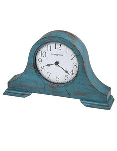 Howard Miller Tamson Mantel Clock In Teal Blue Wood - The Howard Miller Tamson Mantel Clock features a classic tambour silhouette in a rich, aged teal-blue finish. Add to a mantle or side table for instant vintage style. Tabletop Clocks, Mantel Clocks, Mantle, Black Spades, Howard Miller, Wood Mantels, Cool Clocks, Art Van, Blue Wood