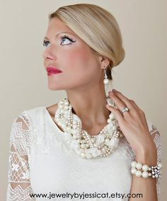 """An absolutely amazing edition to the J by JT """"Grand Twisted Collection"""", featuring ivory, beige, champagne, and almond pearls. This stunning statement necklace also features ivory lace and chiffon ribbon weaved throughout it to give it the most beautiful unique look!   GRAND TWISTED Statement Necklace Ivory Beige by JewelryByJessicaT,"""
