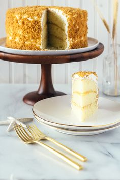 Lemon Crunch Cake Lemon sponge cake, lemon curd, pastry cream, whipped cream frosting and toffee crumble!