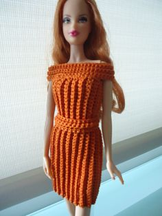 no pattern but looks like a tube crocheted in rib with a top band and a belt