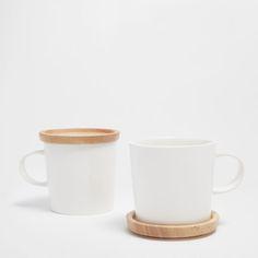Imagem de produto Caneca porcelana base bambu