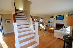SoPo Cottage: The Beach Cottage - Reinventing a 1940's Cape Cod - paint and stain on stairway.