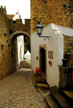 OBIDOS-MEDIEVAL by ruisc_pt  - a very smalll village completely enclosed by lofty medieval walls : streets are cobbled, houses whitewashed with bright blue and yellow borders, #PORTUGAL