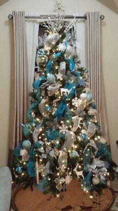 Blue silver and white Christmas decor. Lot of sprays and ribbon. Well balanced design.