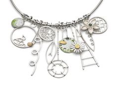Silver, 18ct gold, enamel, peridot necklace .  By Diana Greenwood