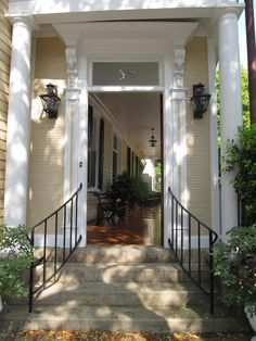 """simple concrete steps and simple hand rail A house in Charleston's historic district has a """"front"""" door that actually leads to steps and the side porch. Wrought Iron Porch Railings, Exterior Stair Railing, Outdoor Stair Railing, Porch And Balcony, House With Porch, Side Porch, Front Porch Railings, Front Stairs, Porch Steps"""