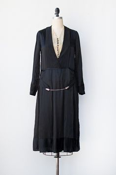 ~Vintage 1920s black dress made from silk with a cream colored lace insert. Black buttons down the center bodice contrast from the lace...~