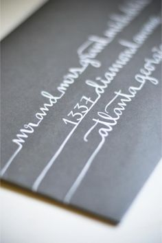 white calligraphy on black wedding invitation - would also be cool white in blue for holiday cards