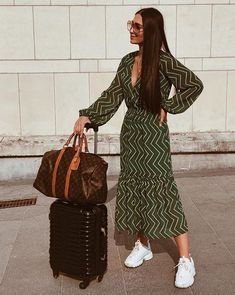 Julie Vanlommel - Bible of fashion ready for her Summer Holiday with her Louis Vuitton Travel bag and Green Dress by An'ge Influencer Sneakers Fila