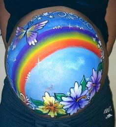 Baby bump Painting. The Blue Leopard Face Painting / Facebook