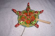 Vintage folk art chicken pecking paddle toy