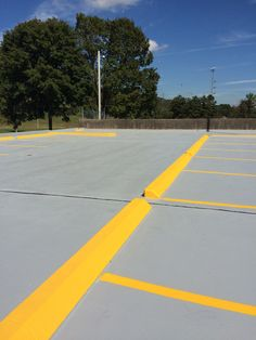 Curb and Wheel Stop Painting in Knoxville TN 865-680-9225 Parking Lot Striping Sevierville TN