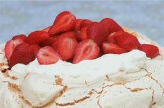 Strawberry pavlova Fresh strawberries, double cream and amaretto liqueur turn this easy-to-make pavlova into a naughty-but-nice dessert