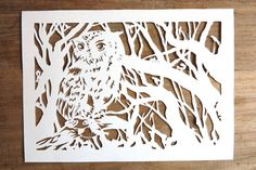 Original handmade papercut of an owl in by WhisperingPaper on Etsy, €33.00