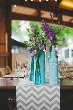 Chevron Table Runners + Painted Bottles for Pops of Color. See more here: http://www.StyleMePretty.com/2014/05/24/horse-farm-wedding-in-saratoga-springs-new-york/ Sj2 Photography - sj2blog.com
