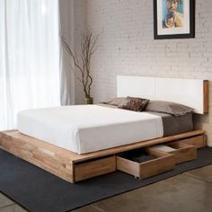 Storage Platform Bed - This is exactly what i want jared to build us except a lil higher up and then i will get rid of our 2 dressers in our room and have more space!