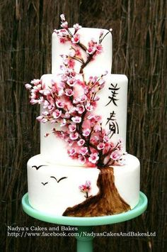 Beautiful cherry blossom cake! Not sure i would paint a whole tree though. just thin branches with the flowers